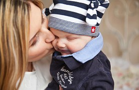 mommy kisses baby